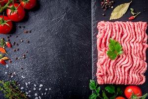 raw minced meat on slate plate, ingr