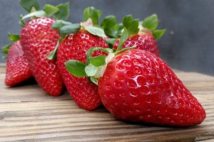 Fresh strawberries on wood