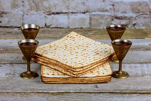 Silver wine cup with matzah Jewish
