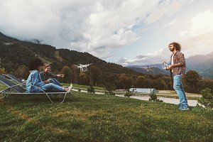 Drone operator and two girls