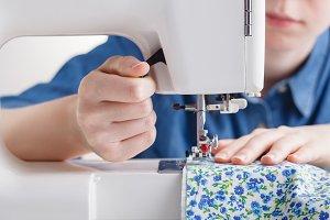 Woman hand sewn fabric