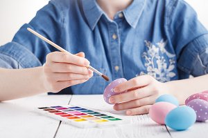 woman painting easter eggs