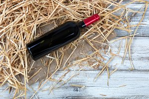 Bottle of Red Wine on Straw