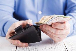 businessman hand holding open wallet