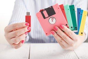 Female hold old floppy disk