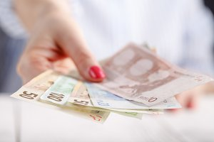Female hands with banknotes