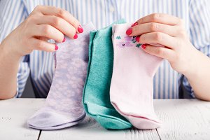 Female hold socks in hands
