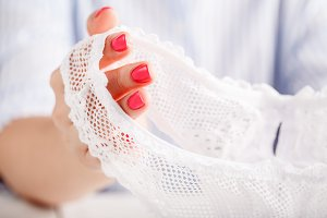 woman holding lace panties