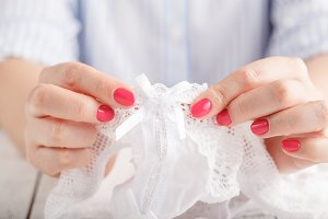 Female fingers hold lace panty