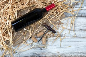 Red wine bottle with old corkscrew