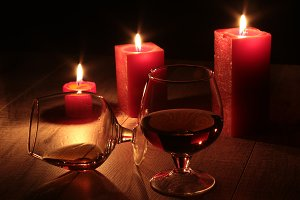 photo cognac glass and candles.