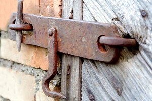 Old lock on the door. true village