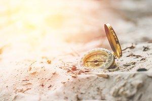 Vintage compass on sand beach