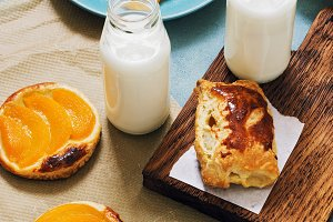 Pies with peach and fresh milk