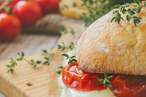 Ciabatta sandwich with tomatoes, her