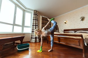 Young gymnast washes floors.