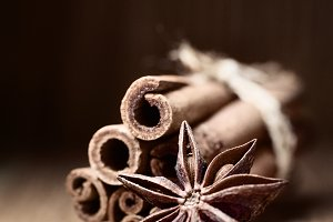 cinnamon and anise on wooden table