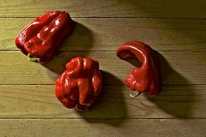 peppers on wooden floor