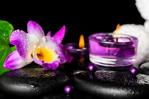 spa setting of purple orchid