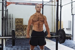 Athlete exercising with heavy weight