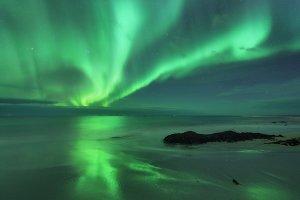 Aurora on the sea. Northern lights