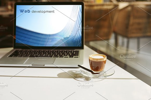 Modern Laptop And Coffee Cup A