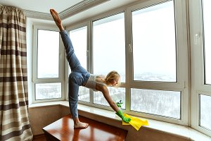 Woman is doing gymnastics while clea
