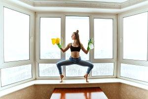 Gymnast washes the windows.