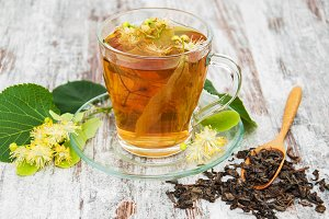 cup of herbal tea with linden flower
