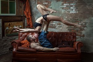 Athletic couple on the bed.