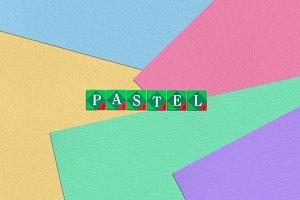 Scrabble letters on pastel paper