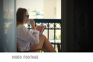 Young woman with touchpad on hotel