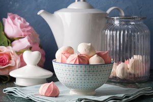 Pink and white meringues in bowl
