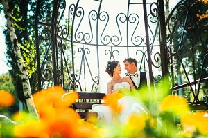 the bride and groom in the gazebo in