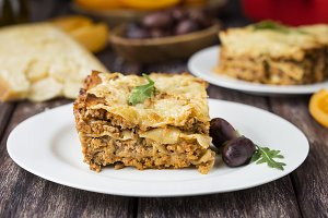 Homemade meat lasagna on wooden tabl