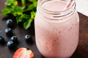 Pink berry smoothie in jar