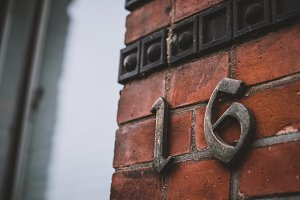Number 16 in Brick Stone Wall