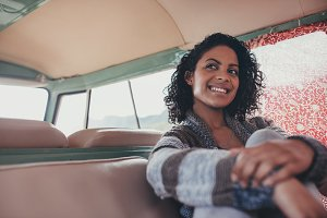 Smiling woman on roadtrip