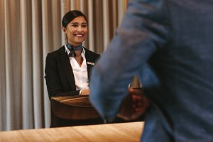 Smiling hotel receptionist