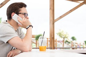 Young guy outdoors with phone. Freel