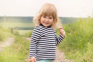 Cute beautiful baby outdoors. Close-