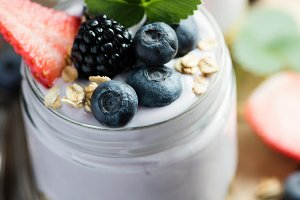 Yogurt and granola with berries