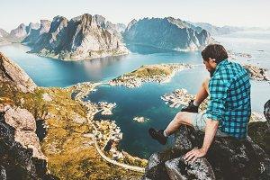 Travel Man sitting on cliff edge