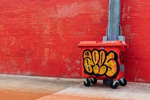 Red Wall and Trash Can