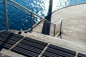 Wooden Dock and Stairs in Sunlight