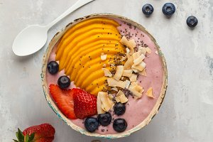 Berry smoothie bowl with mango