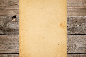 Vintage paper on old wood