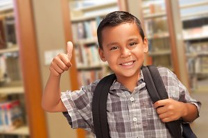 Hispanic Student Boy In Library