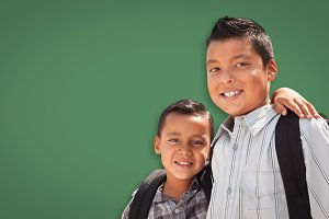 Hispanic Boys, Backpacks on Green