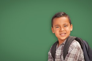 Hispanic Boy with Backpack on Green